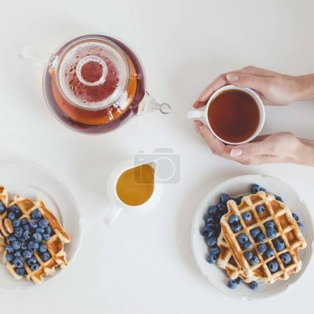 Photo for Top view of tasty breakfast of waffles and tea - Royalty Free Image