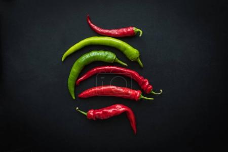 Photo for Top view of red and green fresh chili peppers isolated on black - Royalty Free Image