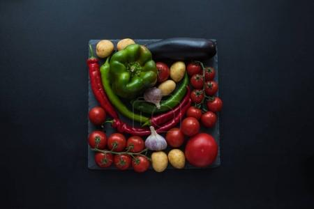 Ripe vegetables and slate board