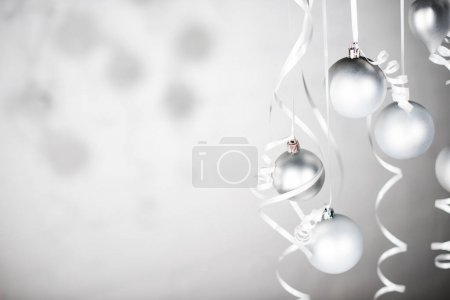 Photo for Close up view of shining christmas toys on ribbons isolated on grey - Royalty Free Image