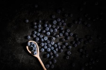 Blueberries and wooden spoon