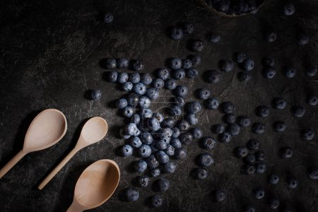 blueberries and wooden spoons