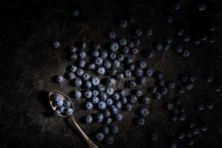 blueberries and vintage spoon