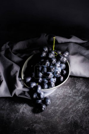 ripe grapes in bowl