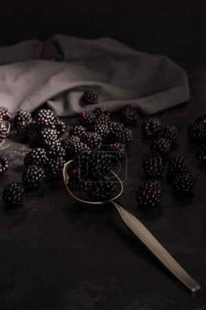 blackberries and vintage spoon