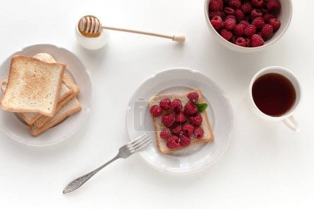 toasts with raspberries for breakfast