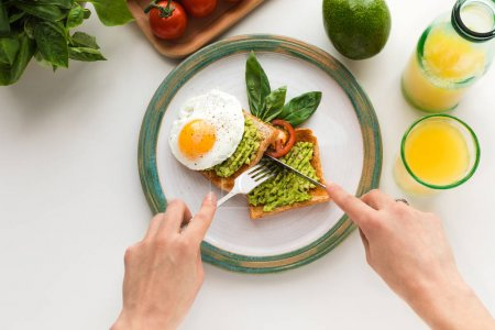 fried egg and avocado on toasts