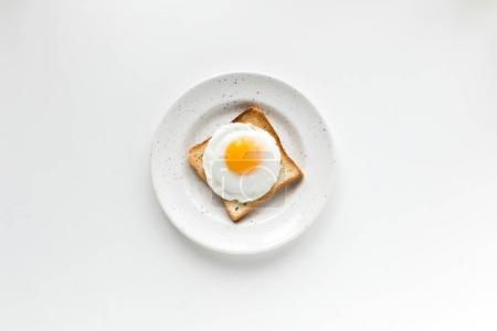 Photo for Top view of breakfast with fried egg on toast, isolated on white - Royalty Free Image