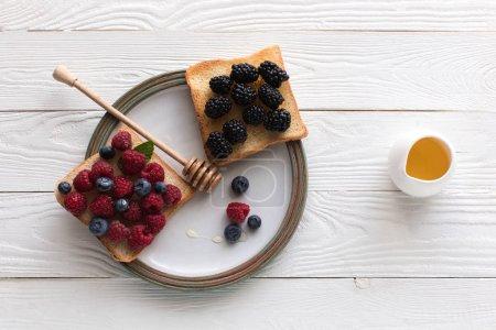 fresh berries on toasts