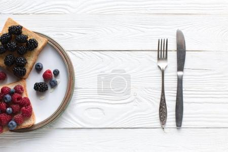 Breakfast with berries on toasts