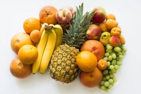 Photo for Top view of Different fresh fruits, isolated on white - Royalty Free Image