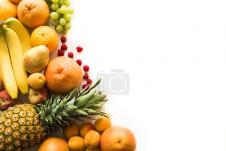 Photo for Top view of Different fresh fruits, isolated on white with copy space - Royalty Free Image