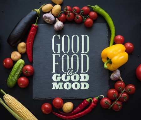 Photo for Top view of various fresh ripe vegetables with board on black - Royalty Free Image