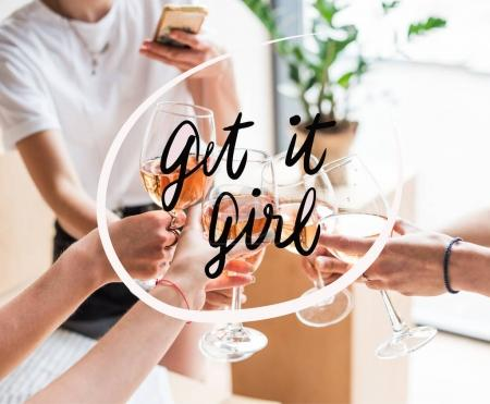 Women clinking with wineglasses
