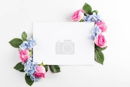 Photo for Floral composition with roses, hydrangea flowers and blank card, isolated on white - Royalty Free Image