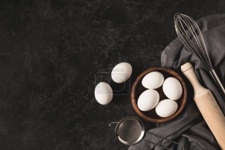 Raw eggs and kitchen utensisl