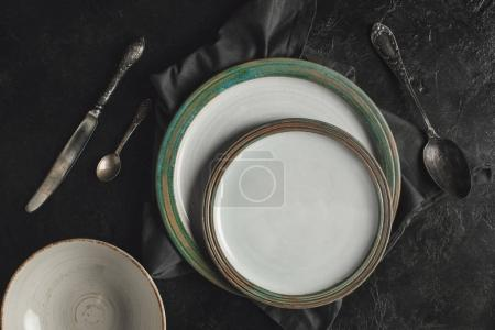 ceramic plates and silverware