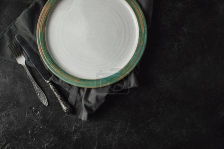 silverware and plate on linen