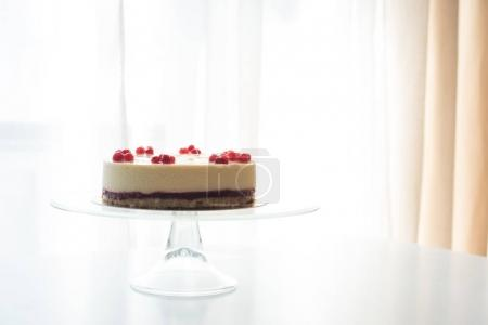 cheesecake with berries on stand