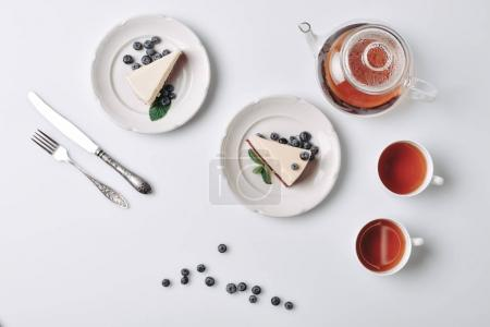slices of cheesecake with blueberries