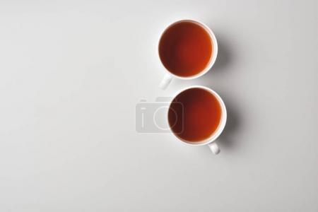 Photo for Top view of cups with delicious tea - Royalty Free Image