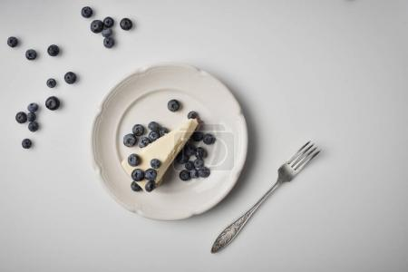 Photo for Top view of slice of cheesecake with blueberries on plate - Royalty Free Image