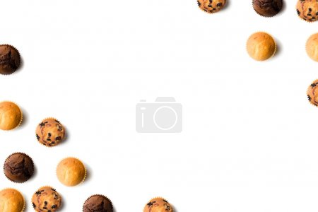 Photo for Top view of various delicious muffins isolated on white background - Royalty Free Image