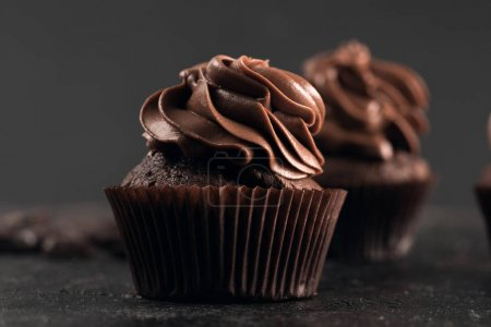 Photo for Close-up view of tasty sweet chocolate cupcakes on black - Royalty Free Image
