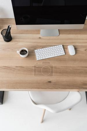 Photo for Top view workplace with computer with wireless mouse and keyboard in modern office - Royalty Free Image