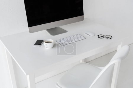 Photo for Workplace with computer and cup of coffee in modern office - Royalty Free Image