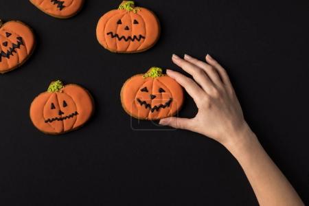 hand with halloween cookies
