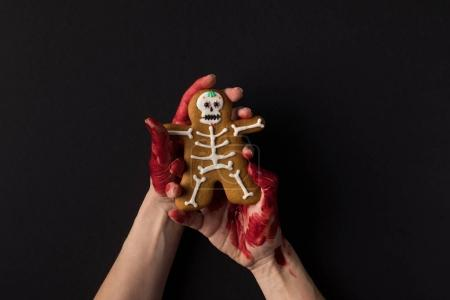 hands holding halloween cookie