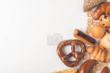 Photo for Top view of arranged sweet bakery isolated on white - Royalty Free Image