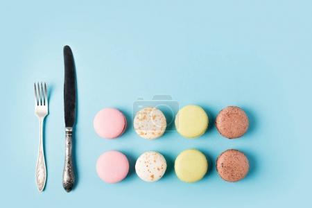 Macarons, fork and knife
