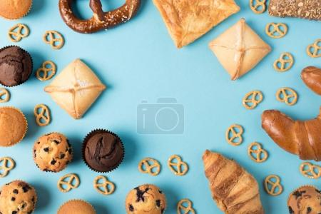 Photo for Close up view of various types of homemade pastry isolated on blue - Royalty Free Image