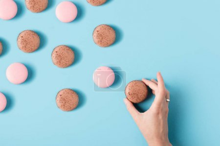 Female hand and macarons