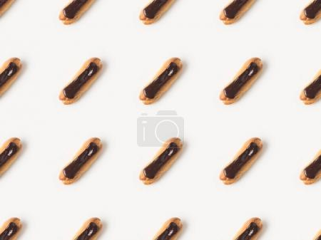 Photo for Flat lay with arranged homemade eclairs with chocolate ganache isolated on white - Royalty Free Image
