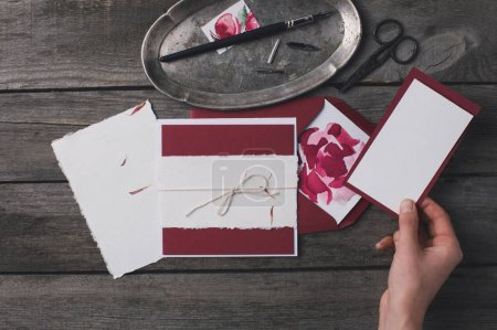 woman preparing holiday invitations
