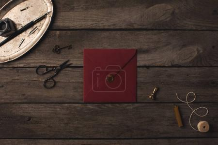 Photo for Composition of red envelope and decorative tools on wooden table - Royalty Free Image
