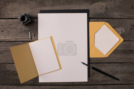 Photo for Composition of blank papers for invitations on rustic wooden table - Royalty Free Image