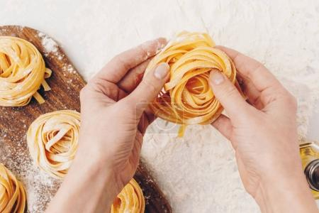 Photo for Cropped shot of woman holding raw pasta nest - Royalty Free Image