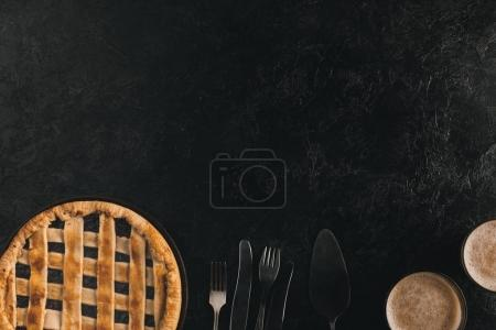 Photo for Flat lay with homemade berry pie, silverware and glasses of cacao isolated on black surface - Royalty Free Image