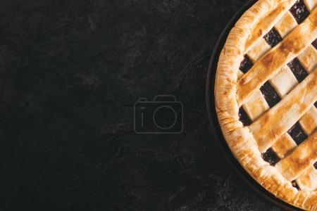 Photo for Top view of homemade pie isolated on black tabletop - Royalty Free Image