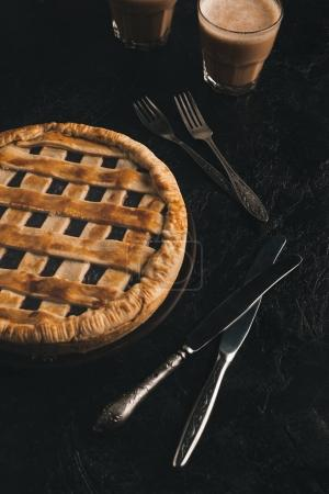 Photo for Close up view of homemade berry pie, silverware and glasses of cacao isolated on black table - Royalty Free Image