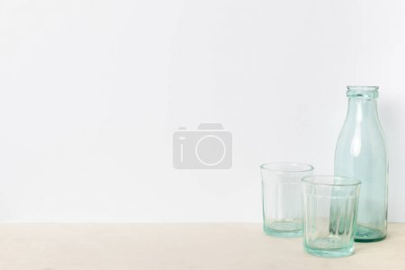 empty glass bottle and glasses