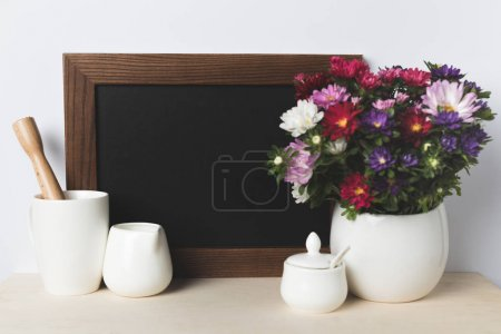 Blank board and kitchen utensils
