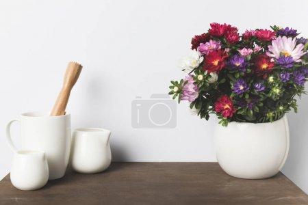 kitchen utensils and flowers