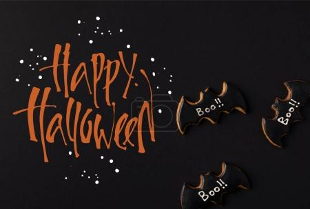 Photo for Close-up view of halloween bat cookies isolated on black - Royalty Free Image