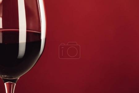 Photo for Close up of glass with red wine isolated on red with copy space - Royalty Free Image
