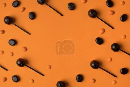Black and orange lollipops